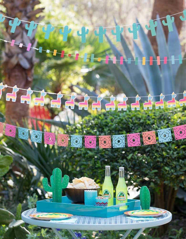 Outdoor Fiesta Cactus Theme birthday party set up with My Minds Eye Cactus Banner, llama banner, Pinata banner, and cactus table toppers for your next Taco Tuesday gathering