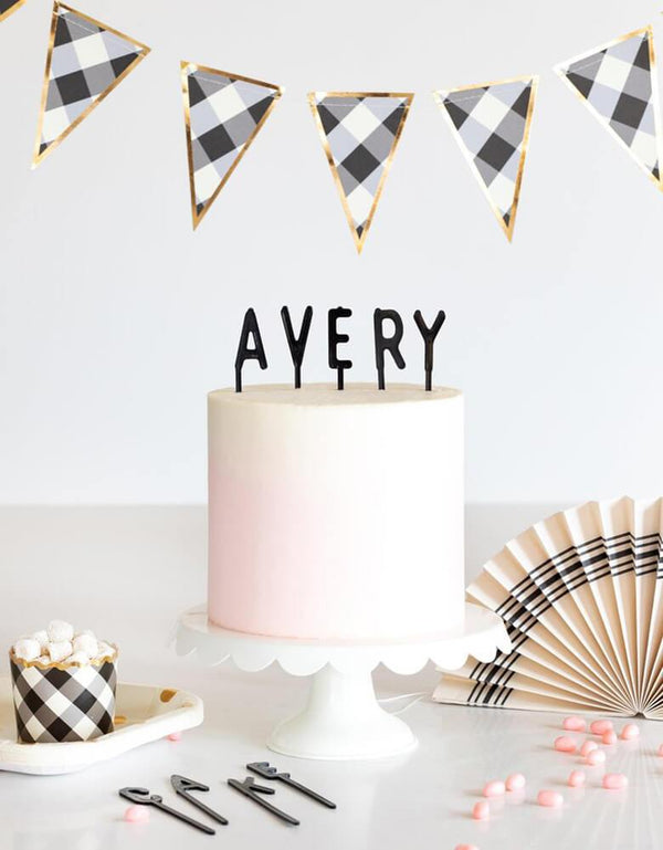 Cake By Courtney Letter-board Cake Toppers on a pink ombre cake with decorations around it