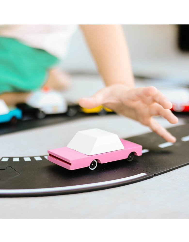 Kid's planning Candylab Candycar Pink Sedan on a toy asphalt road