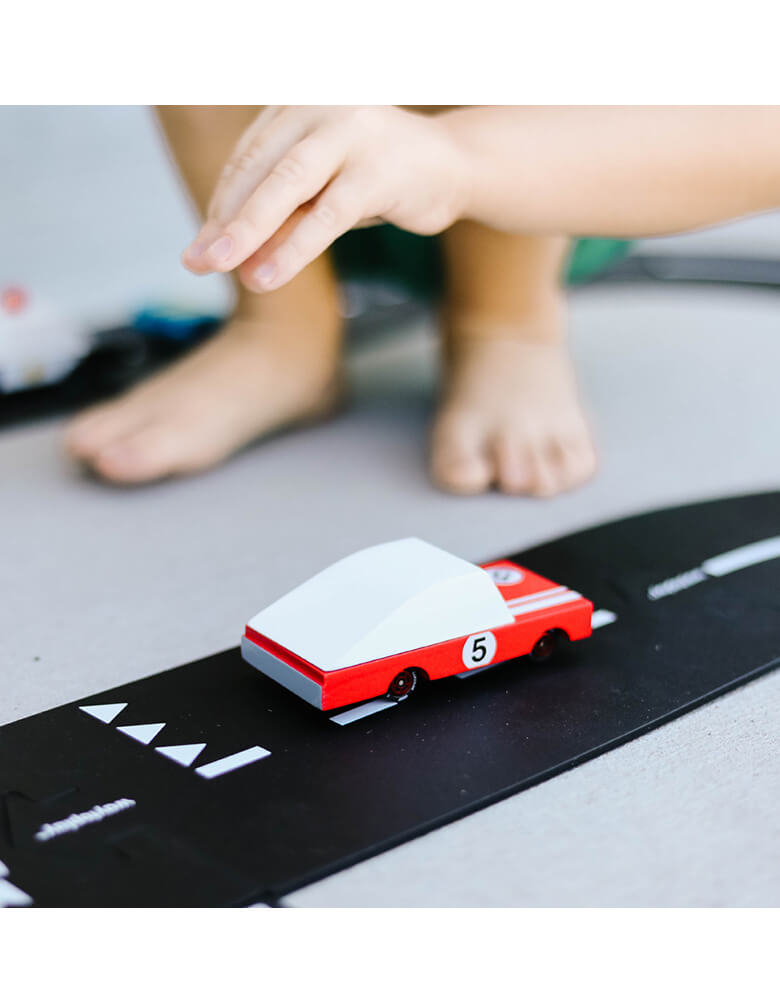 Kids playing Candycar Red Race Car on a toy asphalt road