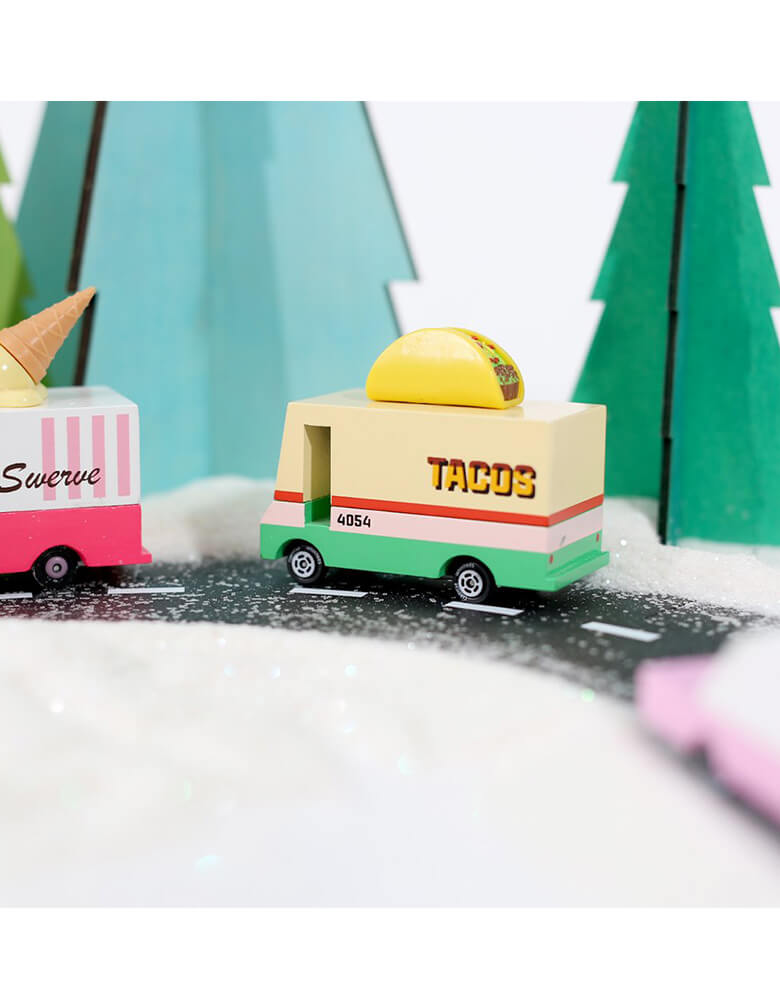 Candylab Candyvan Taco Van on a toy asphalt road with toy trees around