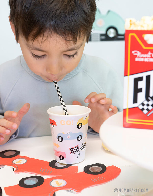 a boy drinking with Meri Meri 9 oz Vintage Race Car Party Cups at a Car themed birthday party