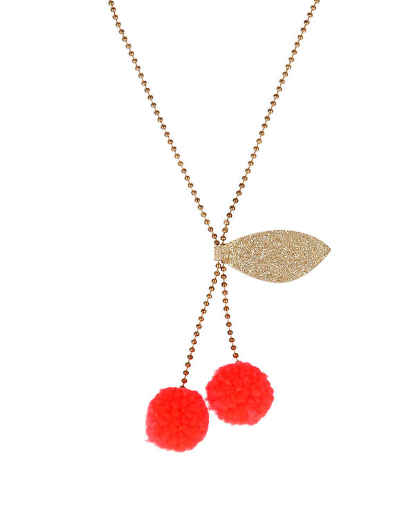 Meri Meri Cherry Pom Pom Necklace. Featuring Yarn pompoms with gold glitter fabric on a Gold enamel bead chain. This beautifully crafted cherry pompom necklace is simply charming. Perfect as a gift for someone who loves quirky accessories.