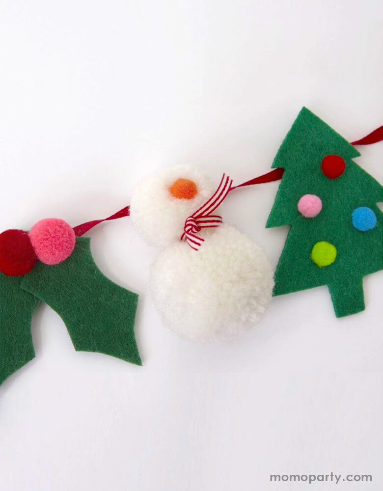 Close up look of Meri Meri Christmas Festive Motif Garland, with snowman pom poms, felt christmas tree and holly & berries. This super cute morden garland is perfect home decoration, nursery decor, wall garland for holiday. Sold by Momo party store provided modern party supplies, boutique party supplies, chic holiday party supplies and high end party supplies