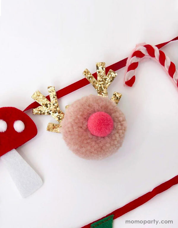 Close up look of Meri Meri Christmas Festive Motif Garland,  with Reindeer pompoms, felt mushroom and candy cane. This super cute morden garland is perfect home decoration, nursery decor, wall garland for holiday. Sold by Momo party store provided modern party supplies, boutique party supplies, chic holiday party supplies and high end party supplies