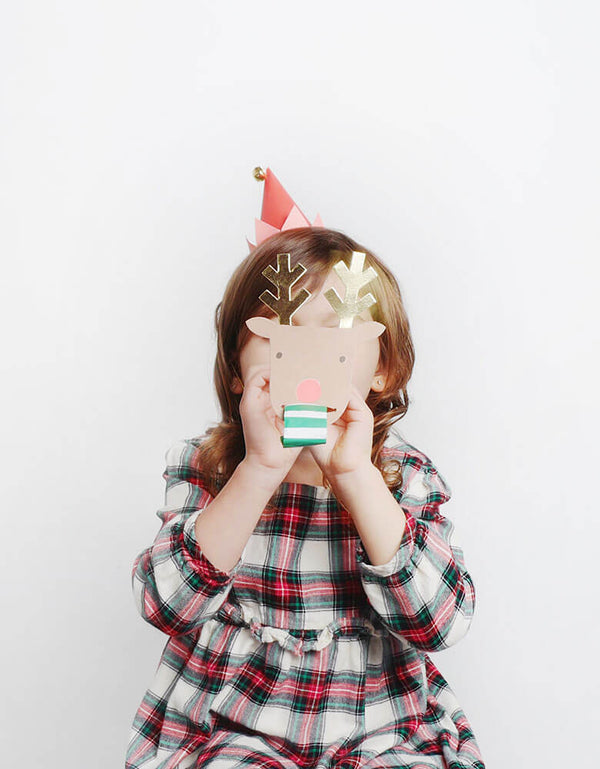 Girl playing Reindeer Party Blower