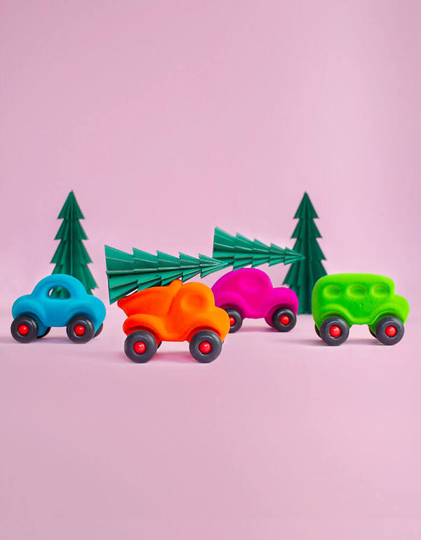 little vehicle toys carrying Christmas trees