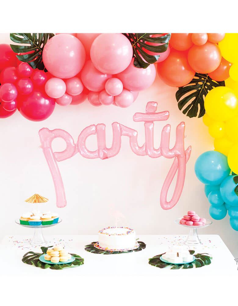"Northstar 44"" Clear Pink Party Script Air-filled Balloon decoration for a Tropical themed party with a colorful balloon garland with tropical palm leaves"
