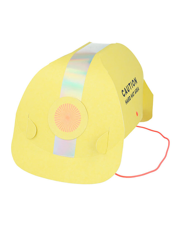 "Meri Meri Construction Party Hats. They are crafted from high quality card and feature the words ""Caution. Hard Hat Area"" in the side of the hat. They have lots of shiny silver holographic foil for a fabulous effect, They are comfortably kept in place with bright orange elastic"