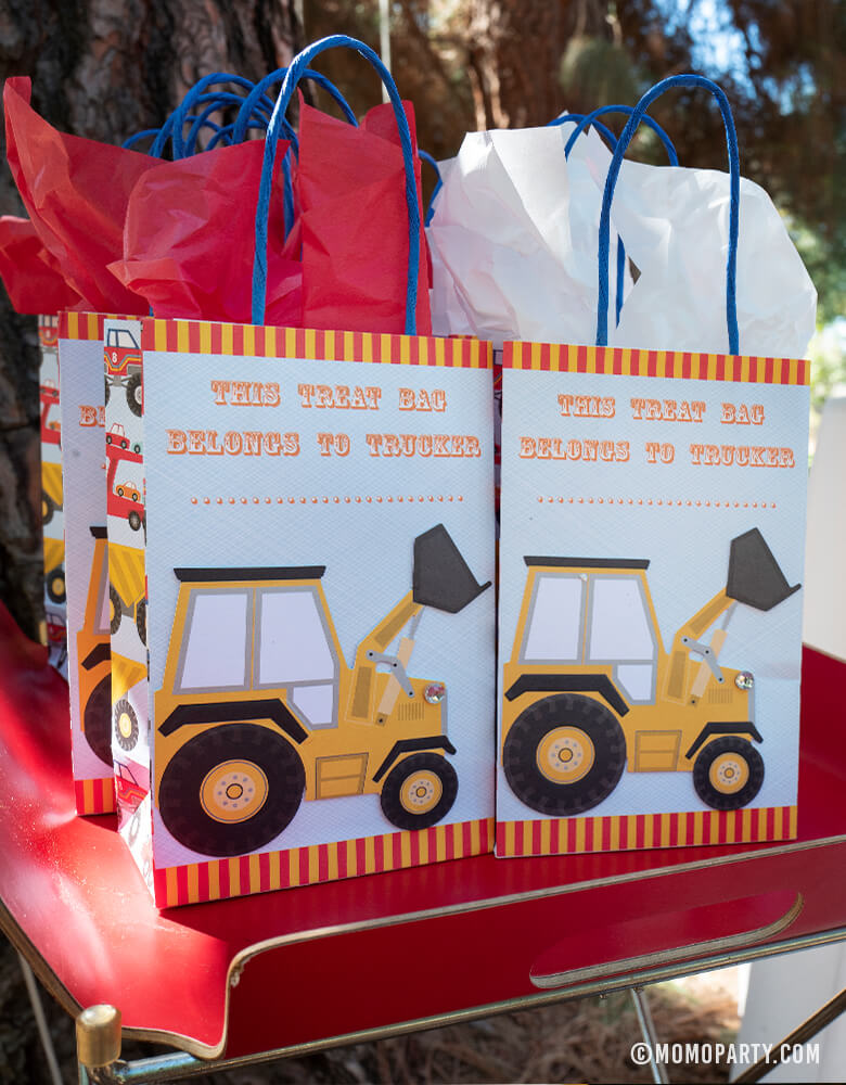 Meri Meri Big Rig Construction Truck Party Goodie Bags on the tray for A boy's Dig in Construction Birthday