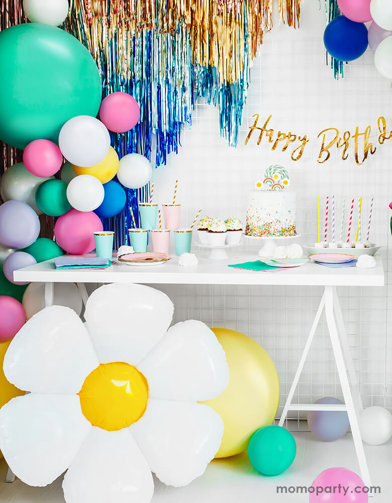 Birthday Party with Party Deco Daisy Foil Mylar Balloon, colorful latex balloons and gold, blue fringe decorated around a birthday party dessert table. Party look for a spring or tea party themed celebration, girls birthday Party