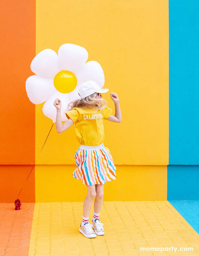 little girl dance in front of colorful painted wall and with Party Deco Daisy Foil Mylar Balloon. this this adorable Daisy petal shapes foil mylar balloon bright your spring or tea party themed celebration