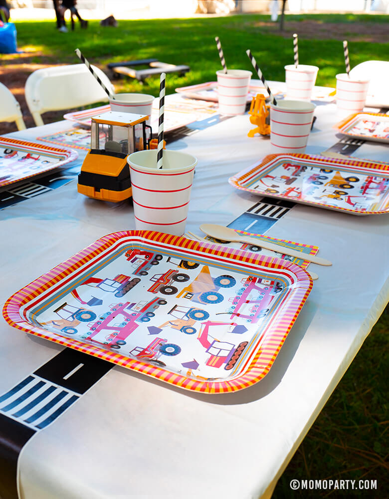Dig-In construction Birthday Party_Outdoor-table set up with Meri Meri Big Rig Large Paper Plates, Red stripe Cups, Digger toys