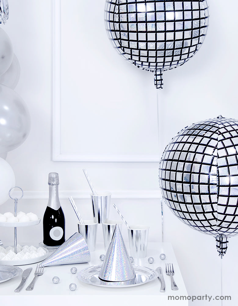 Hip hop disco party with Party Deco sparkly cool disco ball shaped Disco ball foil balloons, champaign bottle, silver iridescent plates, cups and party hats