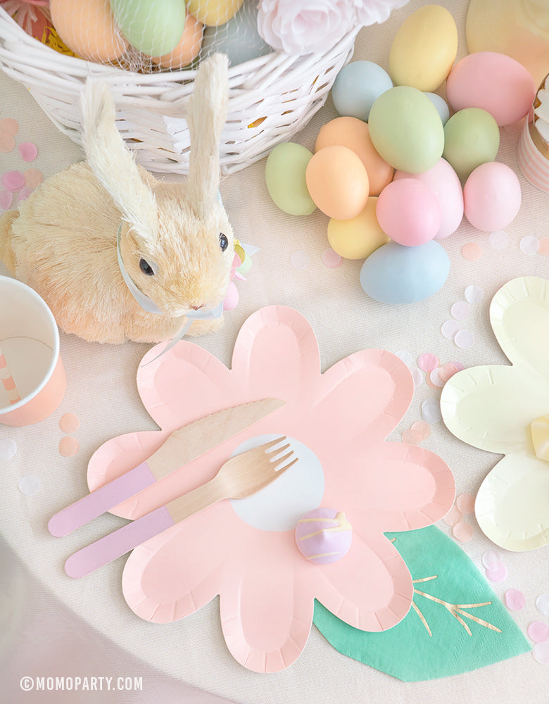 Modern pastel Easter Party celebration idea of Pastel Daisy Large Plates, Pastel Cups, Leaf Napkins and Easter Basket and pastel eggs on the kid's table