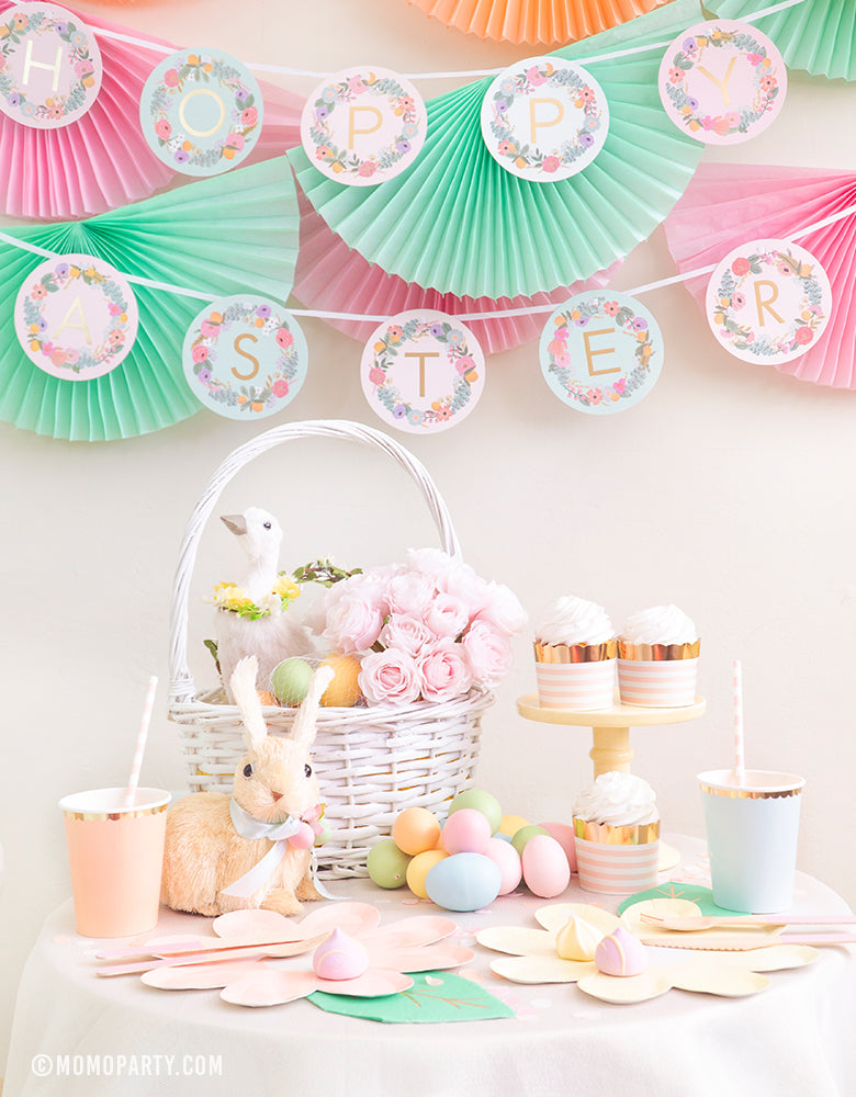 Modern pastel Easter Party celebration idea with Bunting Fan Garlands, Rifle Paper Garden Party Letter Garland backdrops, and Pastel Daisy Large Plates, Pastel Cups, Leaf Napkins and cupcakes on the My Minds Eye Bride To Be 5 oz Blush Striped Food Cup, Easter Basket on the dessert table