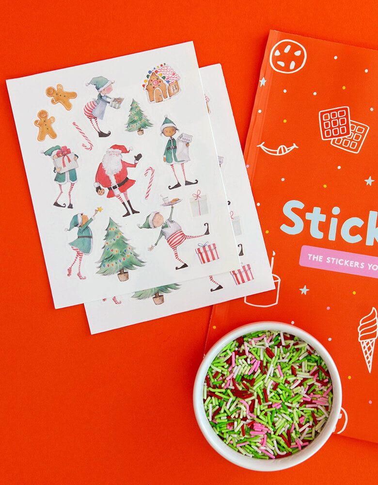 Make Bake shop Elving Around Edible Decorating Stickers, include 2 sheets of many watercolored christmas illustration like nclude edible stickers with santa, elves, gingerbread man, candy cane Stickers, designed by Hello!Lucky for Make Bake. matching Confetti Crunch™ sprinkles with green, red, pink and white colors. Simply peel it and apply to iced cakes, cupcakes, cookies, These easy baking hacks will be These editable stickers make decorating baked goods so much easier this Holiday season