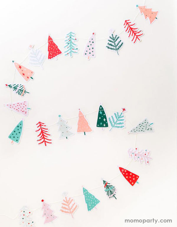 My Minds Eye & Oui Party Collab 6ft Fa La La Christmas Tree Banner in cheery pastel colors spread out on a table