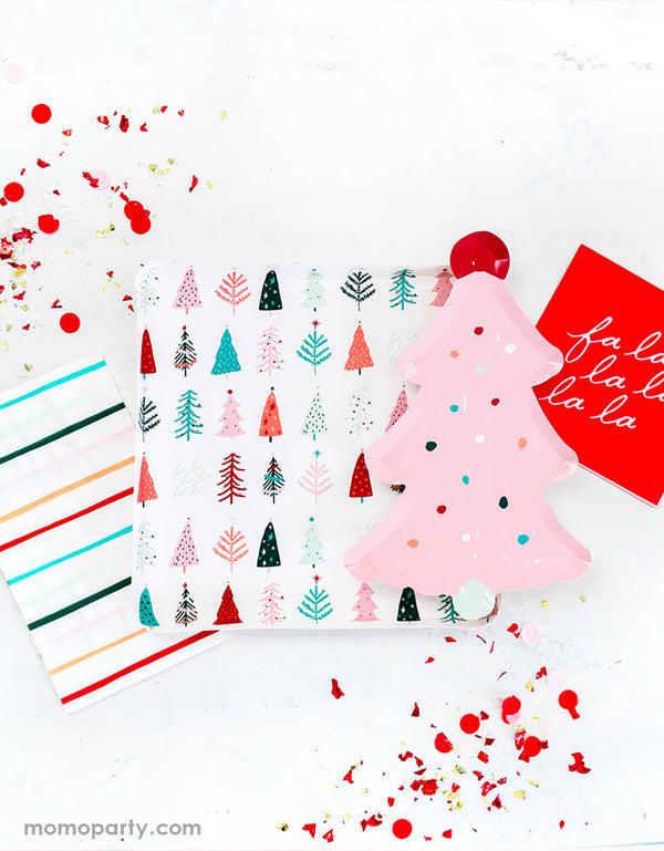 A pink Christmas table filled with My Minds Eye Fa La La Pink Christmas Collection of Fa La La Pink Frosting Christmas Tree Plate,  Fa La La Christmas Trees Plates, and Fa La La Christmas dinner napkin in cheery pastel colors by Oui Party