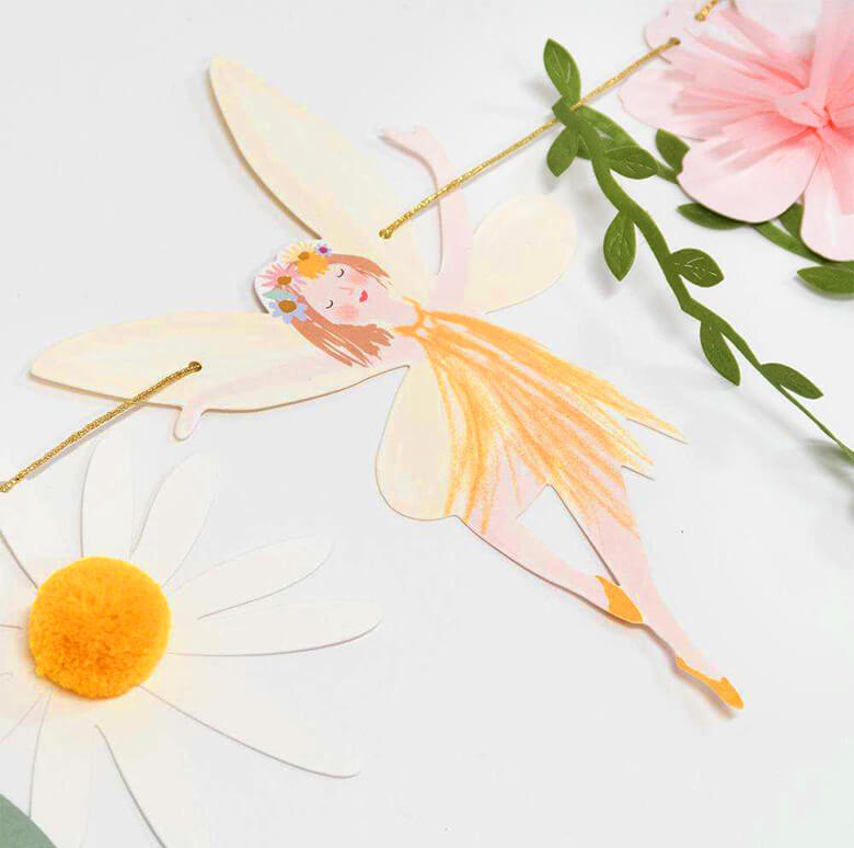 Details of Meri Meri Fairy Garland, A dancing fairy, a daisy flower made by sweet tissue paper tassels and pompoms details,