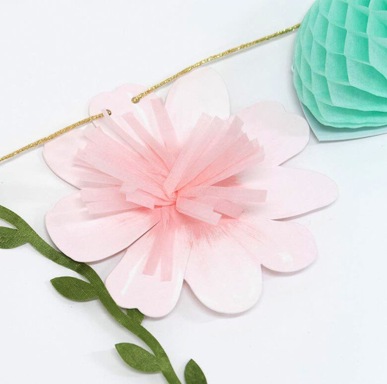 Details of Meri Meri Fairy Garland of The  a pink flower made by sweet tissue paper tassels
