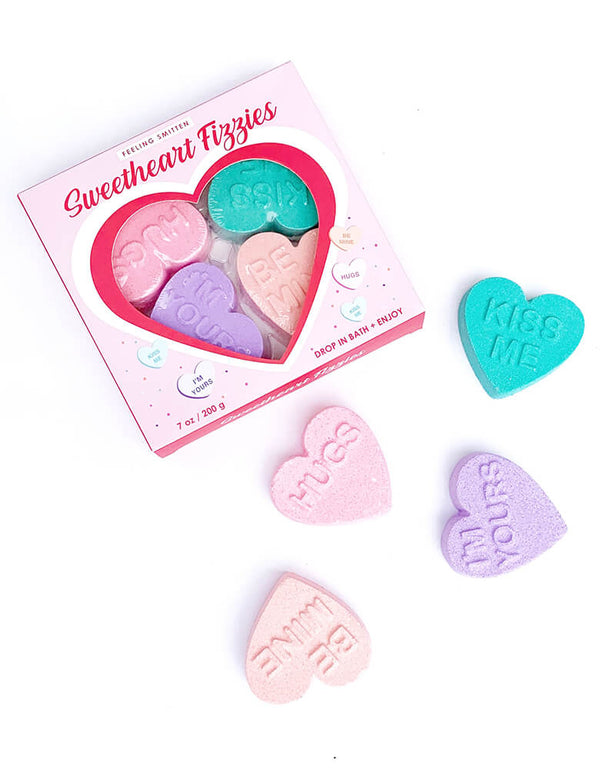 "Feeling-Smitten, Valentine Sweetheart Fizzies Gift Set. Featuring a box with 4 pack of conversation heart shaped fizzy bath treats with ""kiss me"" ""hugs""""be mine""""i Miss you"" text on the heart. Treat your sweetheart or someone you love to a six pack of fizzy bath treats! These sweet-tart scented bath bombs are packed in the perfect box with a TO and FROM white space that's ready for your special message. Relax and enjoy the fizzy goodness. Each sweetheart fizzy is approximately 1.7 ounce."