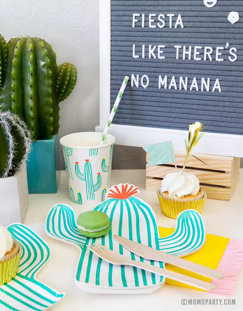 "Fiesta Cactus Theme party set up dessert table with Macaron on the Cactus die-cut plates, Cactus paper cups and Cactus printed straw, cupcakes, mini cactus planter,  and letter board with writing in ""Fiesta Like There's No Mañana"""""
