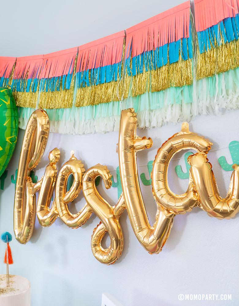Fiesta Cactus Theme party backdrop ideas with Meri Meri Colorful Fringe Large Garland, Fiesta Gold Script Mylar Balloon, My Mind's Eye's Cactus Banner