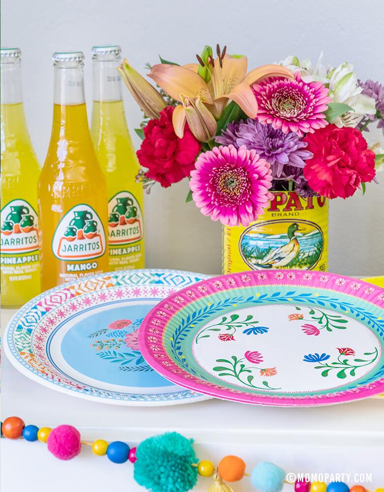 "Talking Tables 9"" Boho Fiesta Floral Paper Plates in Pink and White Blue colors, Flowers inside of salsa cans, Jarritos Mexican soda for A Boho Fiesta Themed Party, Modern Cinco De Mayo Party"