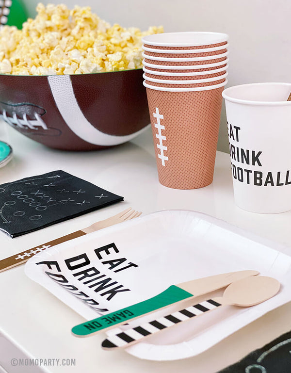 "Super Bowl Football Party table set up with Cakewalk 7"" Eat Drink Football Appetizer Paper Plates, 5"" Game Play Appetizer Napkins, 12 oz Football design Party Paper Cups,"