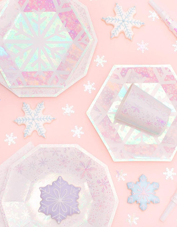 Daydream Society_Frosted Collection_Snowflake Party Goods on a pink background with snowflake cookies on it. Party ware for Winter, Snow, Christmas, Frozen, Frozen 2 Party