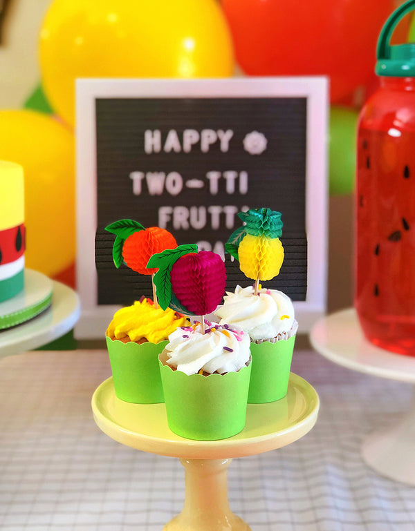 Green Cupcake Baking Cups with honeycomb fruit picks