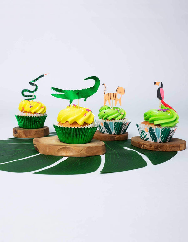 snakes, tigers, crocodiles and toucans toppers on cupcakes