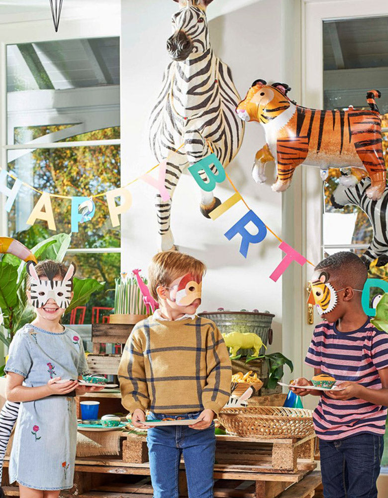 Kids wearAnimals Paper Masks in the Party