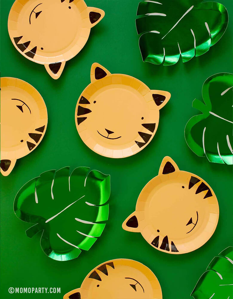 Meri Meri Party ware of Green Palm Leaf shaped Foil Paper Plates with Tiger shaped paper plates on green backgound, Party in a box of tiger paper plate for kids safari theme fun birthday ideas, great party ideas for 1 year birthday