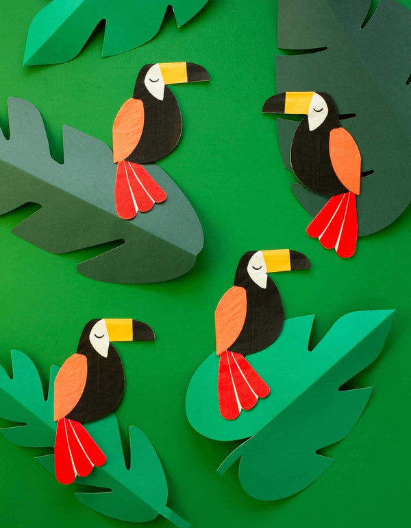 napkins with toucan design on the green leaves