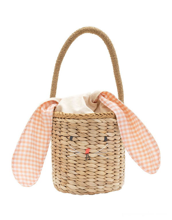 Meri Meri - Gingham Bunny Straw Easter Basket. it has a sweet bunny face, a peach gingham cotton lining, fun floppy ears and a cute pompom tail. Perfect as an Easter basket, or for any special occasion where an adorable accessory will add style.