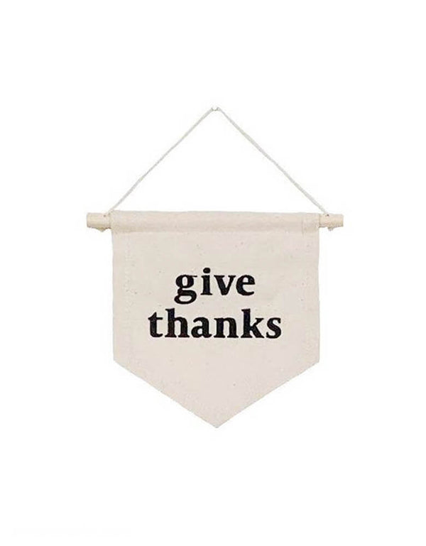Imani Collective Give-Thanks-Hang-Sign Banner, This modern hanging sign was sewn and screen printed by hand on natural canvas by local artisans in Kenya. It's a perfect autumn decoration for your entrance hall or even your little one's playroom!