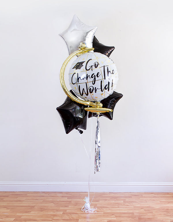 "full look of infalted 26"" Globe with ""Go Change The World"" sign Graduation Foil Balloon and silver star, 3 black star Foil Balloons, ribbon, and a balloon weight for a Graduation Party and Celebration at home"
