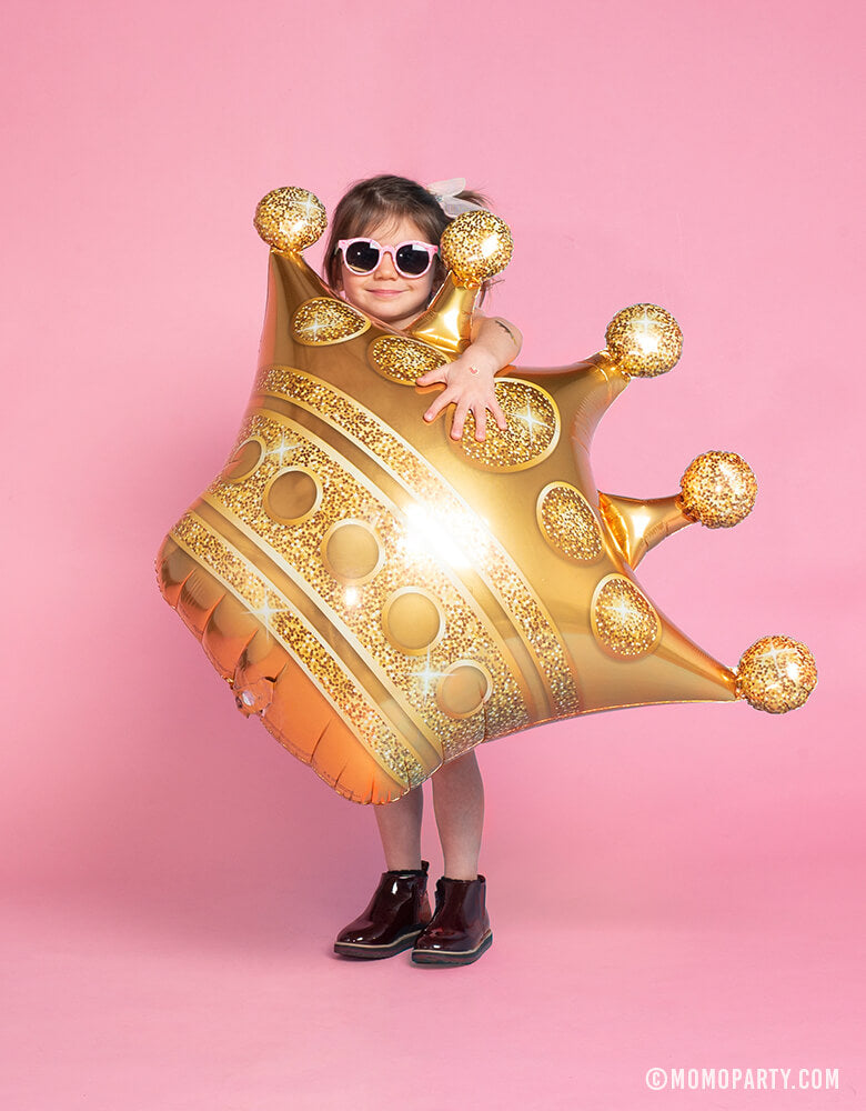 Little Girl holding Gold Grown Foil Mylar Balloon with sunglasses