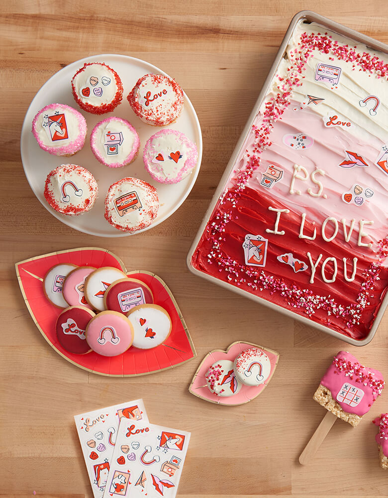 Goodie Goodie Valentine's Day Themed Edible Decorating Stickers on various baked goods including cakes, cupcakes, cookies and rice krispie pops