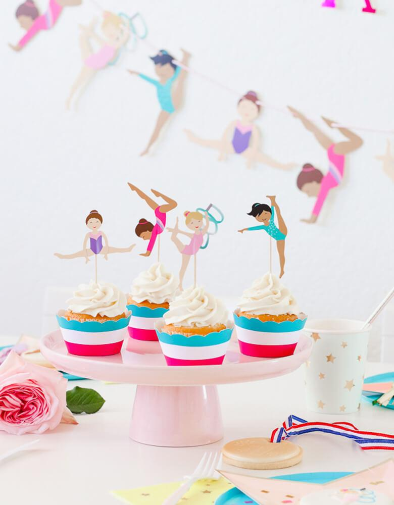 Cupcakes with Gymnastics Themed toppers on a cake stand from a girl Gymnastics Party styled by Twinkle Twinkle Little Party