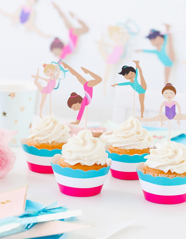 Cupcakes with Gymnastics Themed toppers on a party table from a girl Gymnastics Party styled by Twinkle Twinkle Little Party