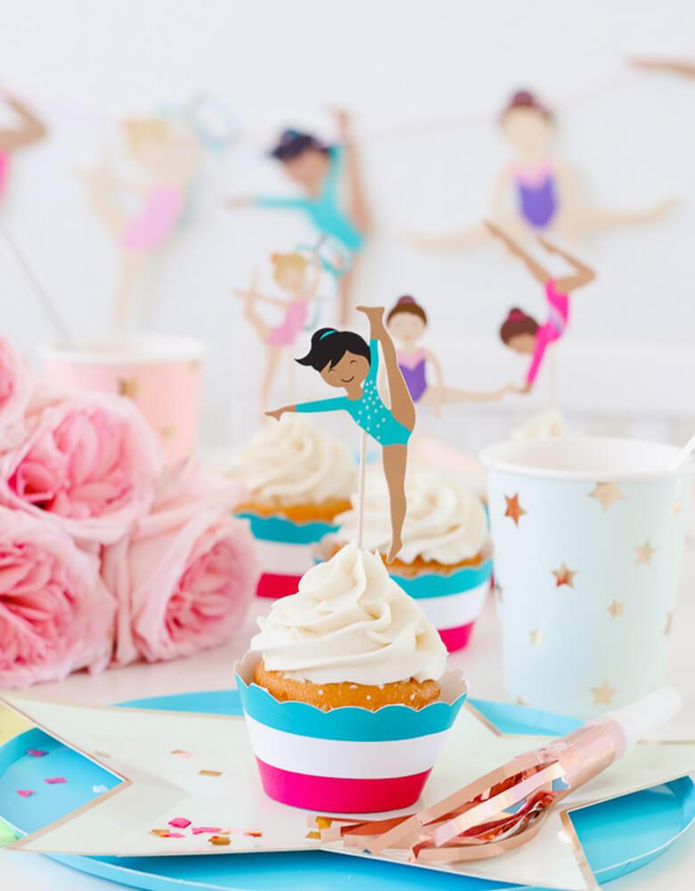 Cupcakes with Gymnastics Themed toppers and star designed tableware for a girl Gymnastics Party styled by Twinkle Twinkle Little Party