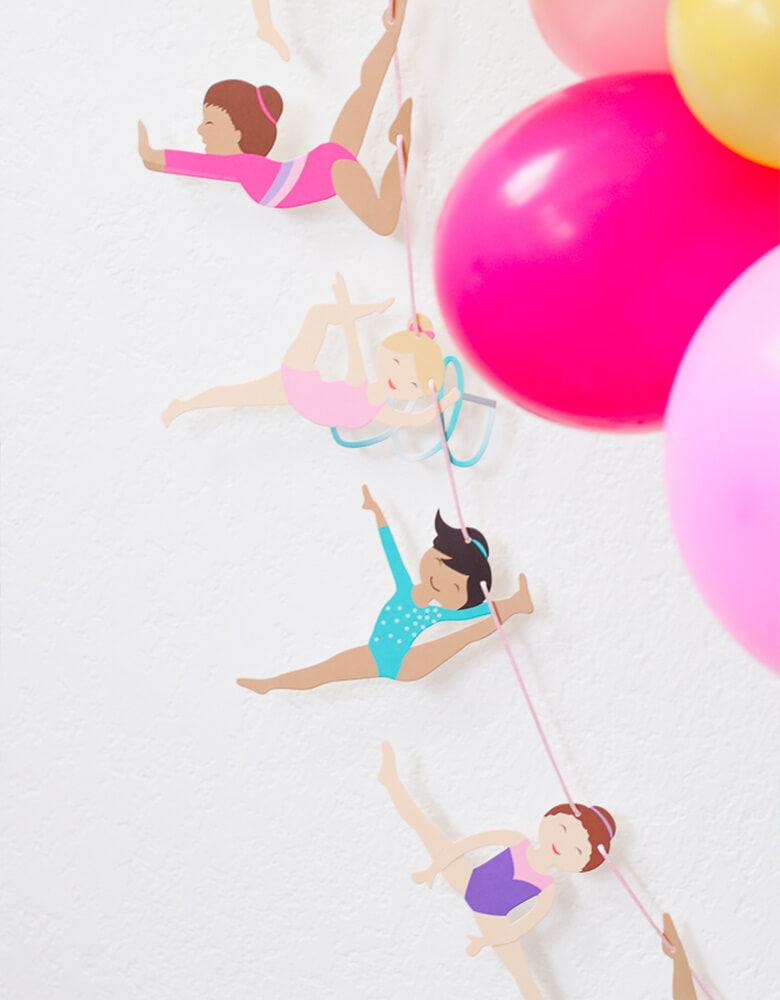 Gymnastics Garland next to a colorful balloon garland in a Gymnastics Themed Birthday Party styled by Twinkle Twinkle Little Party