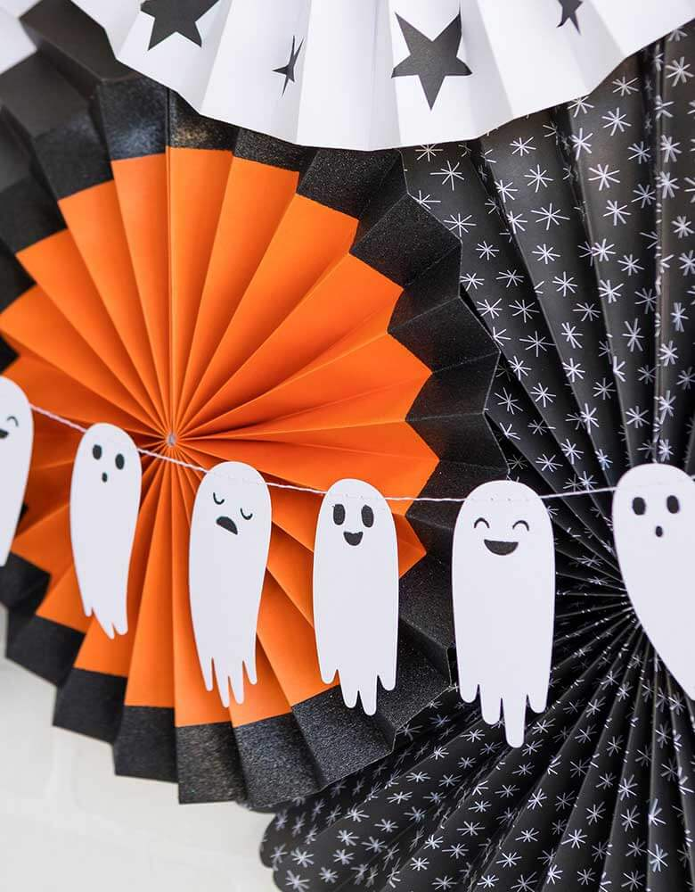 My Mind's Eye Boo To You Ghost Banner hung with a set of halloween themed paper fans in black, orange and white