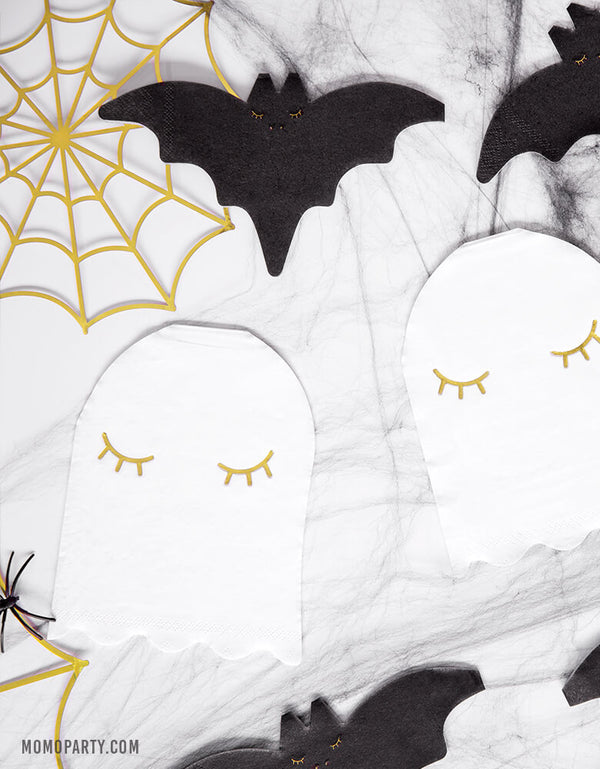 Table with Party Deco Halloween Ghost Napkin, Black bat napkin, and Gold Spider web Decorations. for a Kids modern spooky halloween party, hocus pocus party, trick-or-treating party, nightmare before christmas party, spooktacular halloween party and all halloween related celebrations