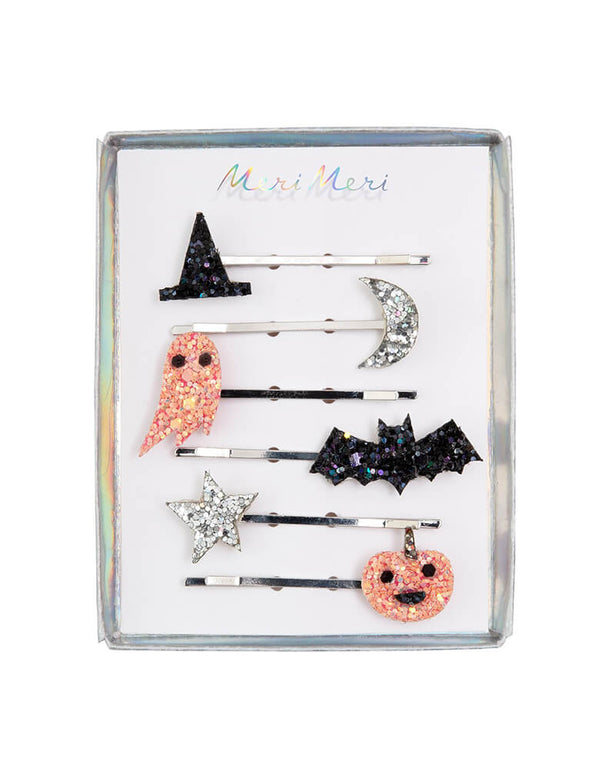 Meri Meri Halloween Icons Glitter Hair Slides with package. Beautiifully crafted with metallic glitter fabric icons, Featuring a witch's hat, pumpkin, ghost, star, moon and bat, all covered with shimmering glitter. They have silver tone hair slides for a stylish look A fantastic gift for little people who love hair accessories, halloween party favors, halloween basket filler, halloween birthday party gift