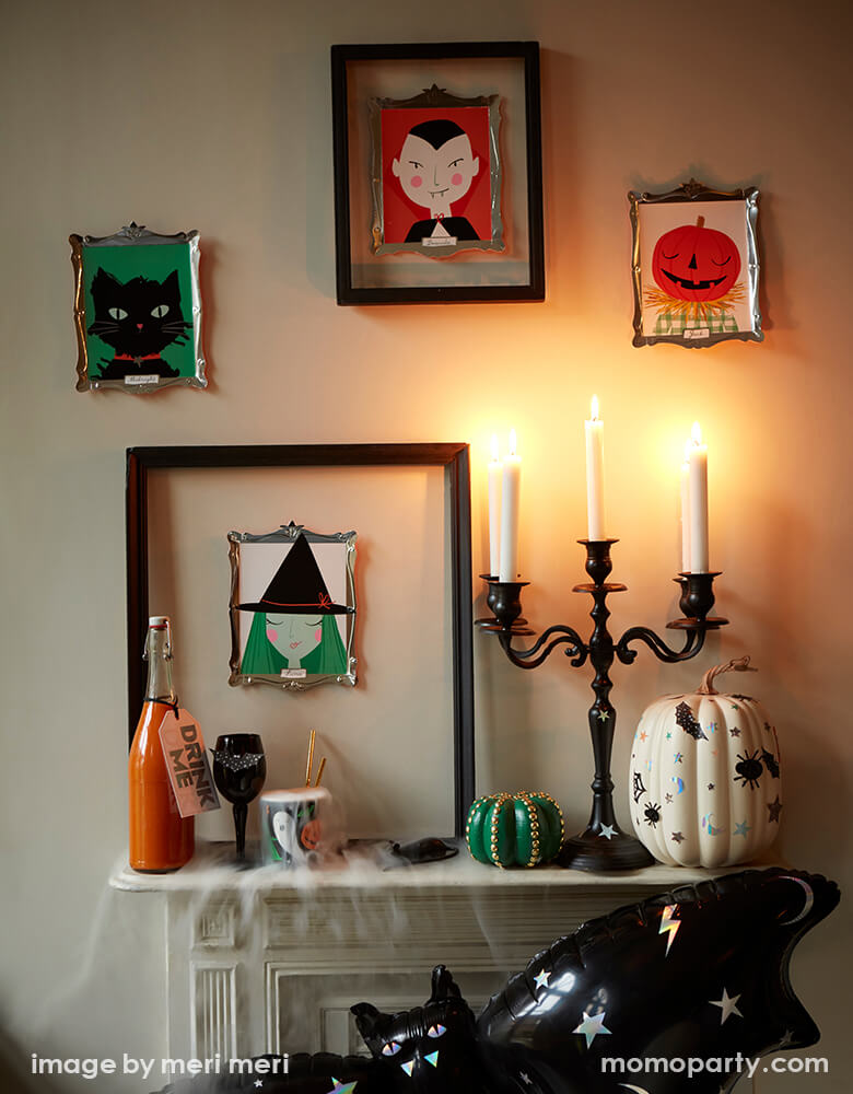 Halloween Party Fireplaces Set up with Sparkle Bat Foil Balloon, Meri Meri Halloween Motif Frame Plates of Vampire Dracula, Luna witch, Midnight the black cat and Jack o'Lantern hanging on the wall, and some plates are inside of frames.  Pumpkin decorated with halloween stickers, These boo-tasticly spooky works of art - worthy of eating Halloween tasty treats off are super cool for halloween party