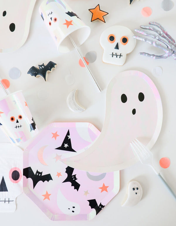 Meri Meri_Halloween-Icons-Side-Plates_with matching Halloween cookies featuring bats, skulls, stars around on a table in a kids halloween party